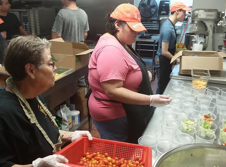 Civitan culinary staff and members prepare meals for Summer Food Service Program.
